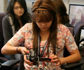 Yetzabell Rojas studies her handheld camcorder during videography class in Phoenix, Friday June 3, 2011. (SJI Photo/Rachel Jimenez)